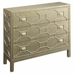 "Finished in a glamorous silver and gold finish, this 3-drawer chest showcases honeycomb overlay for eye-catching style.    Product: ChestConstruction Material: Wood and metalColor: GoldFeatures:  Three drawersMetal handlesHoneycomb-inspired design Dimensions: 34.25"" H x 40.5"" W x 14"" D"