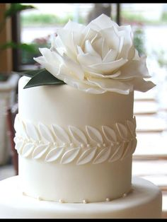 Elegance and simplicity crowned with an oversized gum paste rose by gateaux-inc. wedding cakes cakes elegant cakes rustic cakes simple cakes unique cakes with flowers Beautiful Wedding Cakes, Gorgeous Cakes, Cute Cakes, Pretty Cakes, Fancy Cakes, Fondant Cakes, Cupcake Cakes, White Fondant Cake, Fondant Wedding Cakes