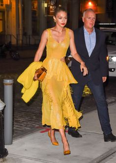 October 16, 2017 After modeling a red version of this Prabal Gurung dress on the Spring 2018 runway, Hadid stepped out in a yellow option. The sequin–and–fringe number features a sexy side cutout, making it the perfect red carpet premiere dress (she was on her way to support Blake Lively's film All I See is You).
