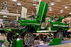 """Sabrina and Marci Ullom's 1961 Chevy Impala was over the top with its emerald green big flake and 26"""" rims."""