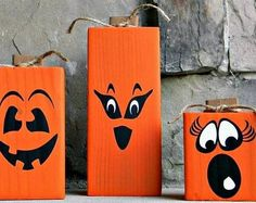 Set of three funny faced wood pumpkin Halloween decorations
