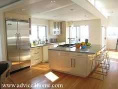 cream modern kitchen cabinets and white wall in modern kitchen