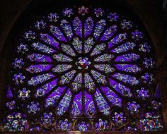 """The Basilica of St Denis, Paris, France: South transept Rose window, subject: Jesse Tree (Ancestors of Christ). Art Nouveau style.     WOW! What a window!  Amazing colour--mauve, I think it is.  Anyways, purplish blue.  A deep, meditative colour, ideal for a mandala, which is what """"rose windows"""" are, in effect."""