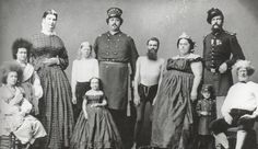 """PT Barnum's """"Living Curiosities."""" In this undated photo are two albinos, three giants, two little people, and two """"circassian beauties""""—women from the Northern Caucasus."""