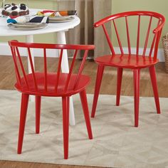 Enhance your dining area with the contemporary charm of these Florence dining chairs. This stylish set is crafted of slid rubberwood and includes two beautiful chairs in your choice of oak,  black, red or white to coordinate with your decor.