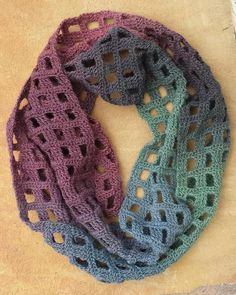 The Windowpane was designed to showcase the colorshifts in gradient yarns like Knit Picks Chroma Fingering, or Noro Taiyo Sock, but you'll also get a beautiful scarf using solid, semi-solid, or variegated yarns.Ravelry: Windowpane Scarf pattern by Adrie Crochet Scarves, Crochet Shawl, Crochet Yarn, Crochet Clothes, Easy Crochet, Crochet Stitches, Infinity Scarf Crochet, Infinity Scarfs, Knit Cowl