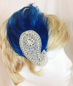 Sapphire blue rooster feather and paisley rhinestone hair fascinator clip on Etsy, $30.00