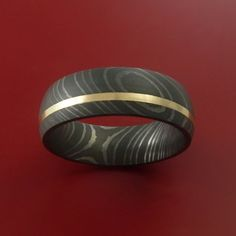 This 7mm wide DAMASCUS ring has an ACID FINISH, with a deep 14K YELLOW GOLD inlay that is POLISHED. Each ring is custom made and the pattern unique, so no two rings are exactly alike. Damascus Steel r