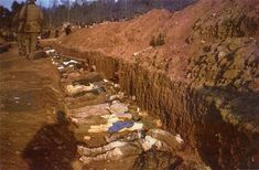 The bodies of prisoners killed in the Nordhausen concentration camp lie in a mass grave dug by German civilians under orders from American troops. Nordhausen, Germany, April 13-14, 1945.