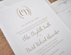 Simple but cute monogram. I like the monogram band for the invites too. @withloveang