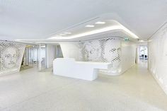 Openness and light are the key characteristics of DGJ+NAU's bank building for Raiffeisen; photo: Jan Bitter  Light was a key consideration for architects DGJ+NAU when designing the flagship branch for Swiss bank Raiffeisen in Zurich. Their aim was to create an open environment that was removed from the stuffy perception of traditional banking and in which customers and staff can engage in a lounge-like environment inspired by high-end retail spaces. The open, light-filled space is divided…