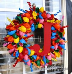 Make a cute birthday or special occasion wreath with balloons for a creative, memorable and easy wreath!