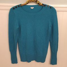 """J.Crew Sz S Button-Shoulder Sweater Blue Merino  J.Crew   Size Small   Button-shoulder sweater   Viscose, nylon, merino wool, alpaca        Excellent used condition!   Bust: 16"""" across the front, lying flat. Has stretch!   Length: 24.75"""" from shoulder to hem.   ✳️ Bundle to Save 20%!  ❌ No Trades, Holds, PP   100% Authentic!    Suggested User // 800+ Sales // Fast Shipper // Best in Gifts Party Host!  J. Crew Sweaters"""