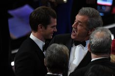 """Mel Gibson Photos Photos - Nominee for Best Director for """"Hacksaw Ridge"""" Mel Gibson (R) speaks with nominee for Best Actor """"Hacksaw Ridge"""" Andrew Garfield (L) at the 89th Oscars on February 26, 2017 in Hollywood, California. / AFP / Mark RALSTON - 89th Annual Academy Awards - Show"""
