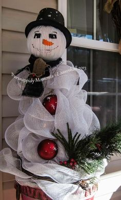 Snowman From Tomato Cages I am in love with the snowmen trees that I am seeing this year. I created a snowman to stand guard at my house this year. He is made from two tomato cages, a glass light globe and a whole bunch of deco ribbon. His head was filled Snowman Tree, Cute Snowman, Snowman Crafts, Christmas Projects, Holiday Crafts, Holiday Decor, Snowmen, Christmas Ideas, All Things Christmas