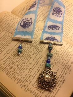 Blue elephant ribbon bookmark hand made with repurposed vintage jewellery and turquoise beads. $15.00, via Etsy.