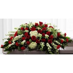 Funeral flower casket spray of red roses with assorted green flowers Large