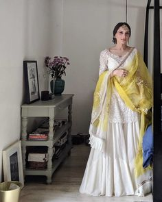 Bride in a short white kurta and sharara pants on her haldi function - indian fashion Sharara Designs, Lehenga Designs, Pakistani Dresses Casual, Pakistani Wedding Outfits, Pakistani Dress Design, Bridal Outfits, Pakistani Mehndi Dress, Indian Wedding Gowns, Pakistani Clothing