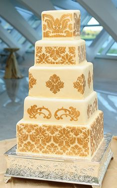 Gold Damask Wedding Cake. Maybe 1 less tier, and a splash of color ( red flowers perhaps).