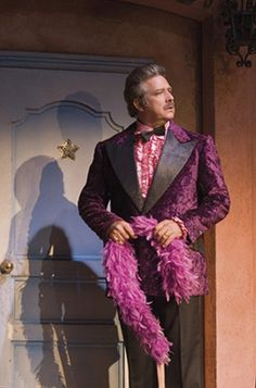Phillip Quast in La Cage Aux Folles. He starred with Roger Allam onstage. Two very handsome men kissing....okay, I'll just back away slowly and go do.....something....