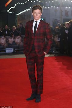 Strong style: The 33-year-old actor looked suitably festive in his red plaid trouser suit