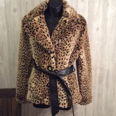 Gorgeous faux leopard jacket Three wood look buttons. Two front pockets. Looks like leather inside at bottom area. Belt also looks like leather but is not and is dark brown in color. Inside lining dark brown and looks like silk but isn't. I wore this twice at the most. Excellent condition. Great to wear with pants. Apostrophe Jackets & Coats