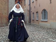 """""""I was also wearing my wedding dress in the fashion show. It is 14th century, made of wool and white rabbit fur. The veil has 200 small pearls attached with silver yarn."""" Turku medieval market. From Hibernaatiopesäke by Sahra"""