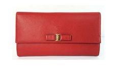 Salvatore Ferragamo Vara Icona Wallet in Red Saffiano Leather with bow $300, originally $425.  This cute little wallet is available though Shop-hers.com - Closet name - Pommeverte