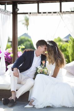 Image by Gypsy Westwood Photography - A Rime Arodaky gown for a wedding at Atzaro in Ibiza. With the groom wearing Paul Smith and bridesmaid dresses from Oh My Love. Photography by Ibizan photographer Gypsy Westwood Photography.