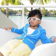 I'm loving her heart shaped sunglasses...so cute! #cornrows