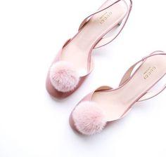 Blush pink Gucci sling backs with pom poms