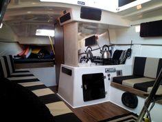 MacGregor 26 Interior with custom cushions and flooring.