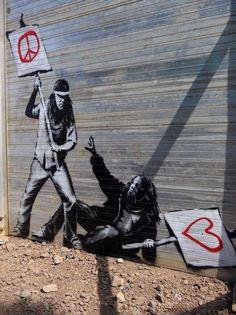 Accordons nos combats ! / Street art. / By Banksy.
