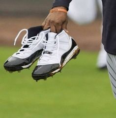 CC Sabathia with the rare Jordan 11 Concord Baseball cleats