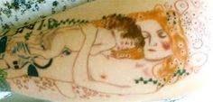 Breastfeeding and Motherhood Tattoos.  This one is from a painting by Klimt.