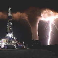 Oil Rig Photo - my dad worked derricks for more than 20 years.  He told a story of a twister touching down on top of the derrick he was on, and having to use the safety lines to slide down to safety.