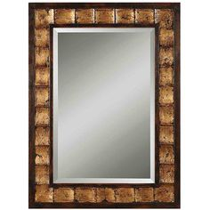 Put the finishing touches on your decor with this beautiful wood framed mirror. With a distressed mahogany finish, this mirror has black undertones and gold leaf detailing. The mirror's generous beveling will add depth and texture to any room.