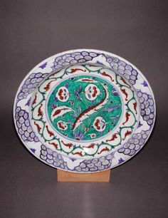 Maker:    Unknown; production    Category:    fritware (stonepaste)    Name(s):    dish  Islamic pottery; category  Iznik; category    Date:    circa 1585 — circa 1590    School/Style:    Ottoman    Period:    late 16th Century