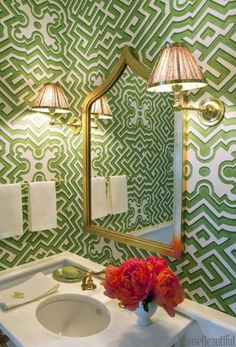 Cole & Son's Palace Maze wallpaper conjures a fanciful parterre in a powder room. Above the Waterworks sink, two Galerie des Lampes sconces with shades in Sister Parish Design's Dots flank the Moorea gold-leaf mirror from Mecox. Powder Room Wallpaper, Bathroom Wallpaper, Of Wallpaper, Graphic Wallpaper, Trellis Wallpaper, Wallpaper Patterns, Wallpaper Designs, Chinoiserie Wallpaper, Cole And Son