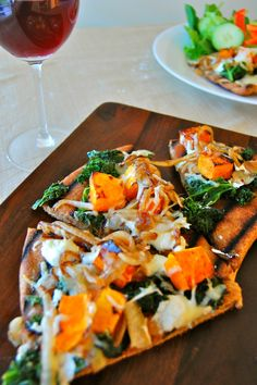 Grilled pizza: Butternut squash, kale, caramelized onions, goat cheese, and mozz. for me tweak and make with vegan cheese and use gluten free crust and vegan soy free butter to caramelize the onions