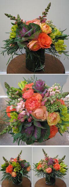 House Martin Floral design. Papaya Ecuadoran roses, purple kale, yellow/green alstromeria, berzellia, coral snapdragons, ranuncula, peach stock, and eucalyptus leaves