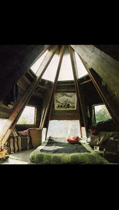 I would love to have a little house somewhere in the mountains with a tower-room like this