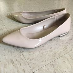 FLASH SALE These nude pointed toe flats are super classy and can be worn to dress up any outfit! They have a small silver accent on the heel which can be used to coordinate accessories with  Express Shoes Flats & Loafers