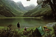 camping and mountains and a lake.