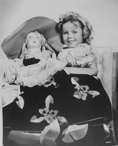 1934 Shirley Temple with a large Dutch doll, a gift from Amsterdam, Holland
