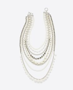 """This can't-miss power piece makes an unforgettable statement with tiers of lustrous pearlized beads, sparkling crystals and metallic chains for a look of infinite polish. Toggle clasp. 32"""" length."""