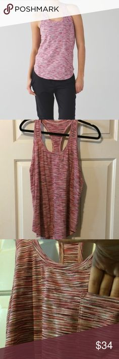 Pink striped lululemon Yogi Racerback lululemon Yogi Racerback. Pima cotton, SUPER soft, curved hem. Swear wicking! Small pocket on front, shown in photo. Worn 1-2 times. Perfect condition. Wanting to consolidate my lululemon collection. lululemon athletica Tops Tank Tops