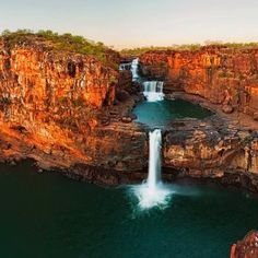 BAD ASS!  {Powerful Mitchell Falls at Dawn}  Mitchell Plateau in the Kimberley Region of Northwest Australia.   It's a 6 image panorama, taken with a Canon 5D Mk II, 17-40mm lens @ 17mm, f/9, ISO125, 1s exposures. Panorama created using AutoPano Pro, and processed using Photoshop CS5.