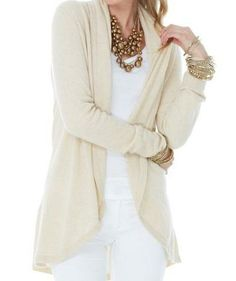 soft wrap cardi over a solid base with a statement necklace