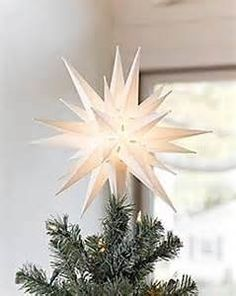 """WARMLY GLOWING MORAVIAN STAR LIGHT - Warm glowing 15w bulb shines beautifully into the night. The 12"""" size is the perfect tree topper for Christmas trees. Match your white Christmas lights with this white tree topper DUAL PURPOSE CHRISTMAS TREE TOPPER OR PORCH LIGHT- Our Moravian star comes with a hook for a porch light and an adaptor for a Christmas Tree. PERFECT 3-DIMENSIONAL DESIGN - Can be enjoyed from all sides & compliments shooting star Christmas lights, and other star Christm..."""